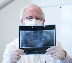 Dr Forbes looking at dental x-ray